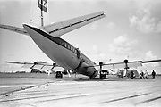 29/03/1963<br /> 03/29/1963<br /> 29 March 1963<br /> B.E.A. Aircrash at Dublin Airport. The crashed BEA Vanguard G-APEJ that carried 43 passengers and seven crew from London to Dublin ploughed its way through half a mile of grassland before returning to the concrete runway, when its front undercarriage appeared to have failed on arrival at Dublin Airport. There were no fatalities in the accident. Note Airport Fire Services vehicle a Thorneycroft Sun Foam Tender in background, also fire officer in door of aircraft. Photos, Photo, Snap, Streets, Street,