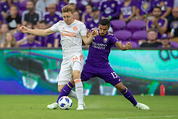 May 13, 2018 - Orlando, FL, U.S. - ORLANDO, FL - MAY 13: Orlando City defender Mohamed El-Munir (13) fights for the ball with Atlanta United defender Julian Gressel (24) during the soccer match between the Orlando City Lions and Atlanta United on May 13, 2018 at Orlando City Stadium in Orlando, FL. (Photo by Joe Petro/Icon Sportswire) (Credit Image: © Joe Petro/Icon SMI via ZUMA Press)