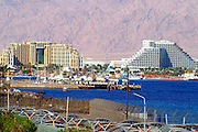 View towards the resort area of Eilat from south Eilat, pop. 55,000, is Israel's southernmost city in the Southern District of Israel. Adjacent to the Egyptian city of Taba and Jordanian port city of Aqaba, Eilat is located at the northern tip of the Gulf of Aqaba, which is the eastern sleeve of the Red Sea.