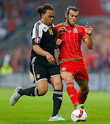 Jason Denayer of Belgium (Celtic) and Gareth Bale of Wales (Real Madrid) in action - Photo mandatory by-line: Rogan Thomson/JMP - 07966 386802 - 12/06/2015 - SPORT - FOOTBALL - Cardiff, Wales - Cardiff City Stadium - Wales v Belgium - EURO 2016 Qualifier.