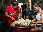 29 APRIL 2014 - BANGKOK, THAILAND: Women sort garlic in their street stall in the Thonburi section of Bangkok.      PHOTO BY JACK KURTZ