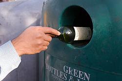 Man recycling a Glass bottle,