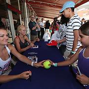 March 8, 2014. Indian Wells, California. Urszula Radwanska and Agnieszka Radwanska sign autographs on Day 4 of the 2014 BNP Paribas Open. (Photo by Billie Weiss/BNP Paribas Open)