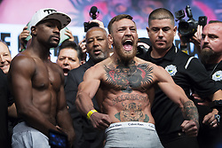 August 25, 2017 - Las Vegas, Nevada, U.S. - FLOYD MAYWEATHER and CONOR MCGREGOR, right, weighed in at 153 pounds during the weighing ceremony prior to the fight at the MOBILE stadium.  (Credit Image: © Joel Marklund/Bildbyran via ZUMA Wire)