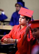 Prospects High School senior Araceli Ortega quietly awaits the start of graduation at Antioch High School on Tuesday, June 5, 2012.   (Photo by Kevin Bartram)