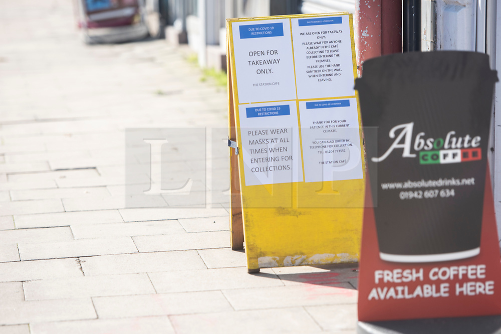 © Licensed to London News Pictures. 09/09/2020. Bolton, UK. A cafe displays a sign for takeaway only on a quiet morning in Bolton as new restrictions are brought in to the local lockdown. Hospitality businesses can only serve takeaway and cannot open between 10pm and 5am.  Photo credit: Kerry Elsworth/LNP