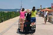 Sunny Beach, Nesebar, Bulgaria..Women in Islamic dress ride a buggy at the start of the summer tourist season at Sunny Beach, the largest holiday resort in the Balkans, and a popular destination for cheap foreign package tours.