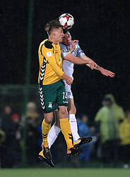 Lithuania's Vykintas Slivka (left) and England's Michael Keane battle for the ball during the 2018 FIFA World Cup Qualifying Group F match at the LFF Stadium, Vilnius.