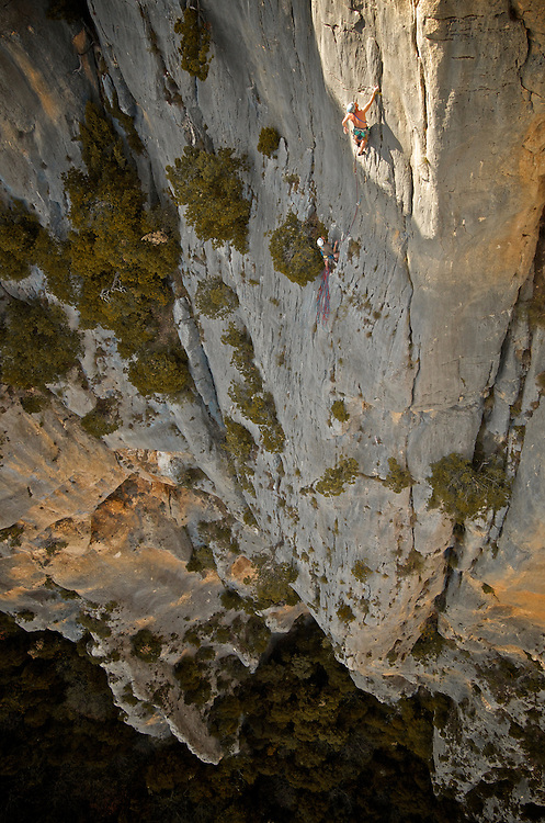 British climber Peter John on the impressive cliffs of Sordidon sector 200m above the canyon of  Verdon, France