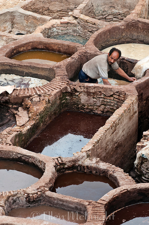 Worker in dye vat at Chouara Tannery in Fes Morroco