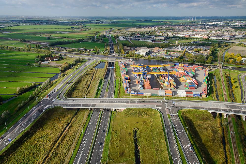 Nederland, Zuid-Holland, Alphen aan de Rijn, 23-10-2013; containeroverslagterminal, binnenvaartterminal gelegen aan rivier de Gouwe. Multimodaal knooppunt: spoor, wegvervoer, water. Naast het bedrijventerrein het Alphen-aquaduct N11 onder de Gouwe en de spoorlijn. <br /> Container terminal located near the River Gouda. Multimodal hub: rail, road, water. Aqueduct (river Gouwe) over the motorway in Alphen aan de Rijn.<br /> luchtfoto (toeslag op standaard tarieven);<br /> aerial photo (additional fee required);<br /> copyright foto/photo Siebe Swart.