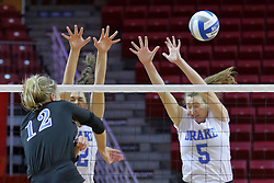 23 November 2017:  Laura Gross hits past Grace Schofield and Natalie Fry during a college women's volleyball match between the Drake Bulldogs and the Indiana State Sycamores in the Missouri Valley Conference Tournament at Redbird Arena in Normal IL (Photo by Alan Look)
