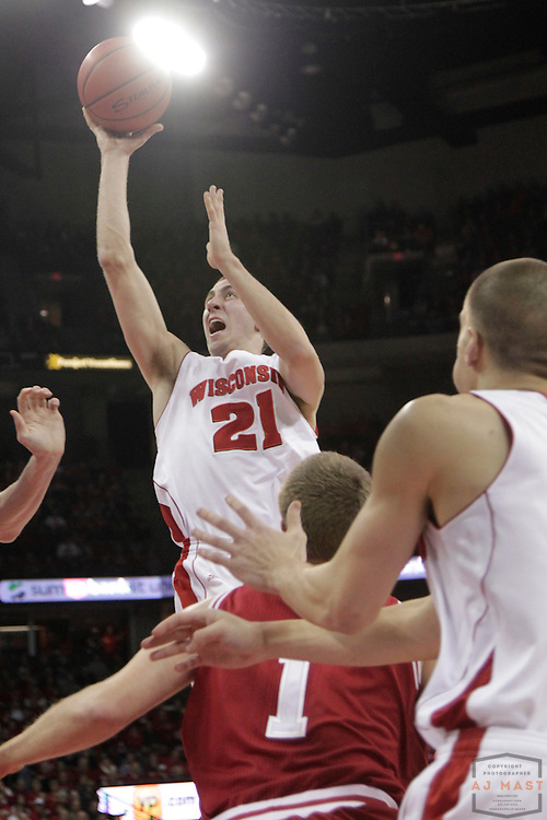 26 January 2012: Wisconsin Badgers guard Josh Gasser (21)  as the Indiana Hoosiers played the Wisconsin Badgers in a college basketball game in Madison, WI.
