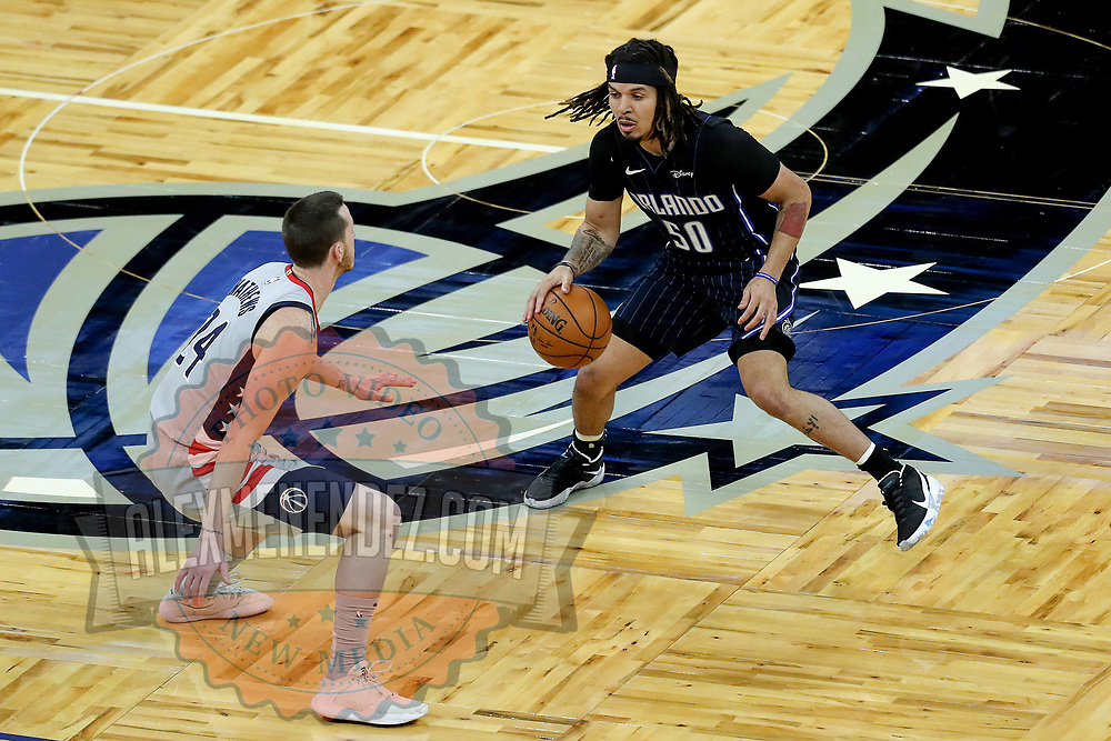 ORLANDO, FL - APRIL 07: Cole Anthony #50 of the Orlando Magic controls the ball against Garrison Mathews #24 of the Washington Wizards at Amway Center on April 7, 2021 in Orlando, Florida. NOTE TO USER: User expressly acknowledges and agrees that, by downloading and or using this photograph, User is consenting to the terms and conditions of the Getty Images License Agreement. (Photo by Alex Menendez/Getty Images)*** Local Caption *** Cole Anthony; Garrison Mathews