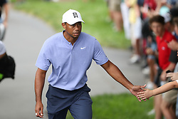 May 30, 2019 - Dublin, OH, U.S. - DUBLIN, OH - MAY 30: Tiger Woods high fives a fan during the first round of The Memorial Tournament on May 30th 2019  at Muirfield Village Golf Club in Dublin, OH. (Photo by Ian Johnson/Icon Sportswire) (Credit Image: © Ian Johnson/Icon SMI via ZUMA Press)
