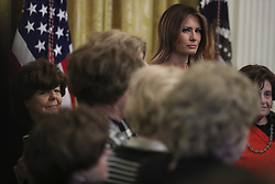 First Lady Melania Trump listens as she stands next to holocaust survivors during a Hanukkah reception with President Donald Trump in the East Room of the White House on December 6, 2018 in Washington, DC. Behind Trump, Vice President Mike Pence. (Photo by Oliver Contreras/SIPA USA)