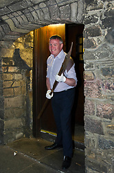 Pictured: Museum Assistant David Mclay defends the town with a halberd<br /> <br /> The latest Museum of Edinburgh exhibition documents the history of Edinburgh's Town Guard, which brought law and order to the city in the 18th century. Curator Nico Tyack and Museum Assistant David Mclay examined muskets, halberds and drums before the exhibition was opened to the public<br /> <br /> Ger Harley | EEm 15 June 2017