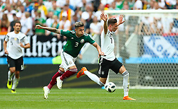 Germany's Julian Draxler appeals for a hand ball by Mexico's Carlos Salcedo