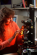 Maja Mataric works on her robot at the  M.I.T., Insect Robot Lab,  Cambridge, MA