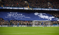 Chelsea fans with a flag remembering the late Ray Wilkins during the Premier League match at Stamford Bridge, London.