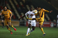 John Akinde of Barnet © is tackled  by Paul Bignot of Newport county ®. EFL Skybet football league two match, Newport county v Barnet at Rodney Parade in Newport, South Wales on Tuesday 25th October 2016.<br /> pic by Andrew Orchard, Andrew Orchard sports photography.