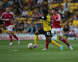 Watford's Ikechi Anya is challenged by Nottingham Forest's Radoslaw Majewski  - Photo mandatory by-line: Nigel Pitts-Drake/JMP - Tel: Mobile: 07966 386802 25/08/2013 - SPORT - FOOTBALL -Vicarage Road Stadium - Watford -  Watford v Nottingham Forest - Sky Bet Championship