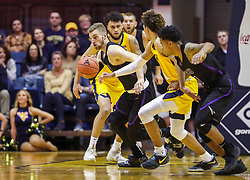 Mar 20, 2019; Morgantown, WV, USA; Grand Canyon Antelopes guard Tim Finke (24) steals the ball during the first half against the West Virginia Mountaineers at WVU Coliseum. Mandatory Credit: Ben Queen
