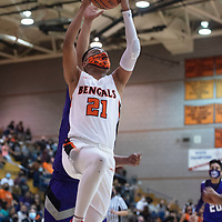 Gallup Bengal Jeffrey Yazzie (21) drives to the basket during a varsity basketball game against cross town rival Miyamura Patriots Tuesday evening at Gallup High School in Gallup.