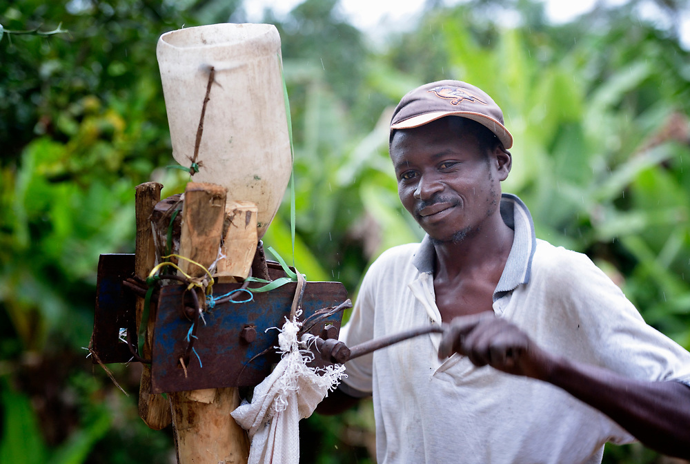 A man grinds grain in Despagne, a rural village in southern Haiti where the Lutheran World Federation has been working with residents to improve their quality of life.