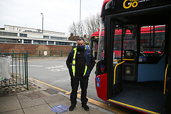 © Licensed to London News Pictures. 23/03/2021. London, UK. A Transport for London staff observes a minute's silence at Turnpike Lane Bus Station in north London to remember the over 126,000 people who have died from Covid-19, and the many more lives that have been impacted. A total of 88 London transport workers have died in the pandemic, 51 of them bus drivers. Photo credit: Dinendra Haria/LNP