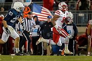 Ameer Abdullah breaks away for a 50-yard run. The run was originally a 62-yard TD run but was called back due to a personal foul. Nebraska defeated Penn State 23-20 in overtime. © Aaron Babcock