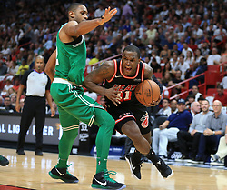 November 22, 2017 - Miami, FL, USA - The Miami Heat's Dion Waiters (11) drives the ball around the Boston Celtics' Al Horford in the third quarter at the AmericanAirlines Arena in Miami on Wednesday, Nov. 22, 2017. The Heat won, 104-98. (Credit Image: © Al Diaz/TNS via ZUMA Wire)