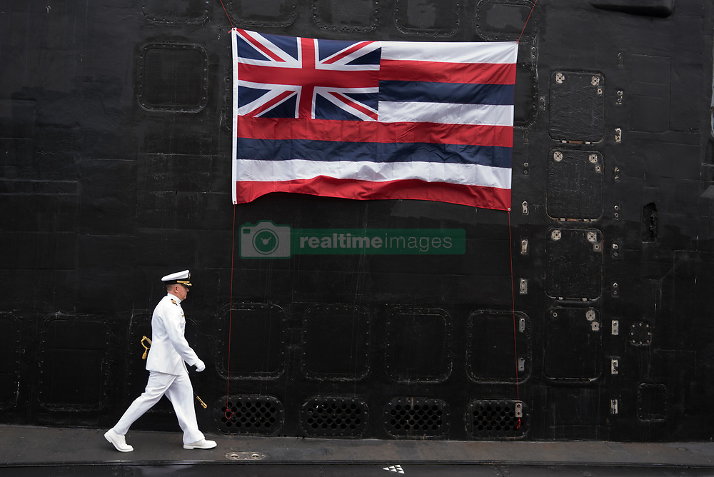 PEARL HARBOR (Aug. 2, 2018) Capt. Richard Seif, commander of Submarine Squadron (SUBRON) 1, walks to the podium aboard the Virginia-class fast-attack submarine USS Hawaii (SSN 776) during a change of command ceremony on the submarine piers at Joint Base Pearl Harbor-Hickam, August 2, 2018. Cmdr. Sterling S. Jordan relieved Cmdr. John C. Roussakies as Hawaii's commanding officer. (U.S. Navy photo by Mass Communication Specialist 1st Class Daniel Hinton/Released) 180802-N-KC128-064