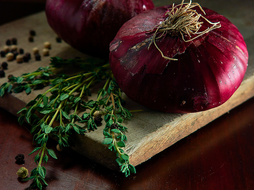 Onion and thyme on wood .