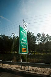 Road signs. Photographs from a bus. Sunday 2nd Jan, 2011. Day three visit to a kibbutz. Train & Travel is a unique ten day program designed for IKMF's instructors, students & guests, interested in combining Krav Maga training with a tour of the holy land. .©2011 Michael Schofield. All Rights Reserved.