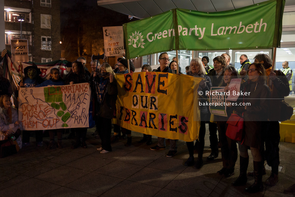 Residents and campaigners against the closure by Lambeth council of Carnegie Library protest outside the borough's planning committee meeting, on 7th February 2017, at Bolney Meadow Community Centre, south London, England. Leisure contractor GLL were given the go-ahead to run the 100 year-old, listed building in Herne Hill as a pay-to-go gym in the excavated basement, a facility that few locals want, preferring a fully-stocked library with books and librarians. £12,600 was donated by the American philanthropist Andrew Carnegie to help build the library that opened in 1906. It is a fine example of Edwardian civic architecture, built with red Flettan bricks and terracotta, listed as Grade II in 1981. Shut by Lambeth council and occupied by protesters for 10 days in April, the library has been locked ever since because, say Lambeth austerity cuts are necessary. 24hr security on the building has been more expensive to keep closed than open.