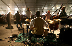 30 April 2006. New Orleans, Louisiana. Jazzfest . <br /> The first New Orleans Jazz and Heritage festival following the disaster of Hurricane Katrina. <br /> Legendary local jazz trumpeter Kermit Ruffins of the band Kermit Ruffins and the Barbecue Swingers plays at the Bellsouth WWOZ Jazz tent.<br /> Photo ©Charlie Varley/varleypix.com<br /> All rights reserved.