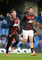 Manchester United's Shinji Kagawa warms up with team-mate Michael Carrick (right) before the game