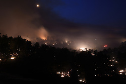 July 27, 2018 - Redding, California, USA - Redding, California, U.S. - The Carr fire outside of Redding in northern California grew to nearly 29,000 acres Thursday and continued to show strong fire activity all night. (Credit Image: © Neal Waters via ZUMA Wire)