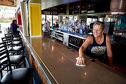 October 7, 2016 - Florida, U.S. - Suzette Nangle, shift supervisor, re-opens Mulligan's Beach House bar and grill for the lunch crowd in Jensen Beach Friday.  Nangle said luckily, they never lost power. (Credit Image: © Richard Graulich/The Palm Beach Post via ZUMA Wire)