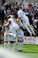 Swansea city's Danny Graham is mobbed by teammates after he scores his sides 3rd goal. . Barclays Premier league, Swansea city  v West Ham Utd at the Liberty Stadium in Swansea, South Wales  on Saturday 25th August 2012. pic by Andrew Orchard, Andrew Orchard sports photography,
