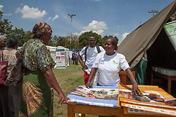 LUSAKA, Dec. 1, 2016 (Xinhua) -- A woman consults a staff member during an activity to raise awareness on World AIDS Day in Lusaka, capital of Zambia, on Dec. 1, 2016. (Xinhua/Peng Lijun) (zy) (Credit Image: © Xinhua via ZUMA Wire)