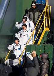 Expedition 54 flight engineer Scott Tingle of NASA, top, flight engineer Norishige Kanai of Japan Aerospace Exploration Agency (JAXA), middle, and Soyuz Commander Anton Shkaplerov of Roscosmos, bottom, wave farewell prior to boarding the Soyuz MS-07 rocket for launch, Sunday, December 17, 2017 at the Baikonur Cosmodrome in Kazakhstan. Tingle, Norishige Kanai, and Shkaplerov will spend the next five months living and working aboard the International Space Station. Photo by Joel Kowsky / NASA via CNP/ABACAPRESS.COM