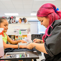 Katie Rae Pablo, 6, left has her nails done by Michelle Guillen, during the Relay for Life Spa Day fundraiser at  the University of New Mexico - Gallup Cosmetology Department in Gallup Monday.
