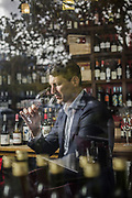 John Eales former Australian Rugby Union captain testing wine for Halliday Magazine.
