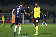 Tom Hopper and Lucas Akins shake hands after the EFL Sky Bet League 1 match between Burton Albion and Southend United at the Pirelli Stadium, Burton upon Trent, England on 3 December 2019.