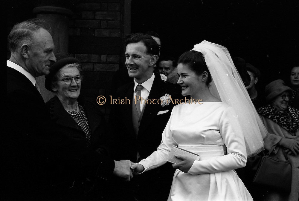 06/02/1964<br /> 02/06/1964<br /> 06 February 1964<br /> Wedding of Sean Manley and Eithne Lydon at University Church Dublin. pictures after the ceremony were Mr Sean Manley elder son of Mr and Mrs Tadhg Manley, St. Luke's Place, Cork and Miss Eithne Lydon (a Former actress with the Abbey Theatre and Taibhdheare na Gaillimhe) daughter of Mr and Mrs Thomas Lydon, Abnegate Street, Galway.  Picture shows Mr and Mrs Tadhg Manley congratulating the bride and groom.