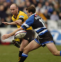 Photo: Richard Lane.<br />Bath Rugby v London Wasps. Zurich Premiership.<br />07/02/2004.<br />Alex King chips past his England rival, Ollie Barkley.