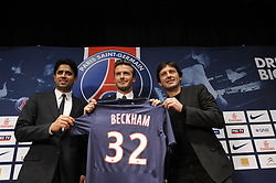 British and New PSG football player David Beckham flanked by PSG Qatari president Nasser Al-Khelaifi (L) and Brazilian sport director Leonardo, poses with his new jersey at the end of a press conference at the Parc des Princes stadium in Paris, France on January 31, 2013. Beckham signed a five-month deal with the Ligue 1 leader until the end of June. Photo by Mousse/ABACAPRESS.COM