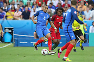 France Midfielder Dimitri Payet battles with Portugal Midfielder Renato Sanches during the Euro 2016 final between Portugal and France at Stade de France, Saint-Denis, Paris, France on 10 July 2016. Photo by Phil Duncan.